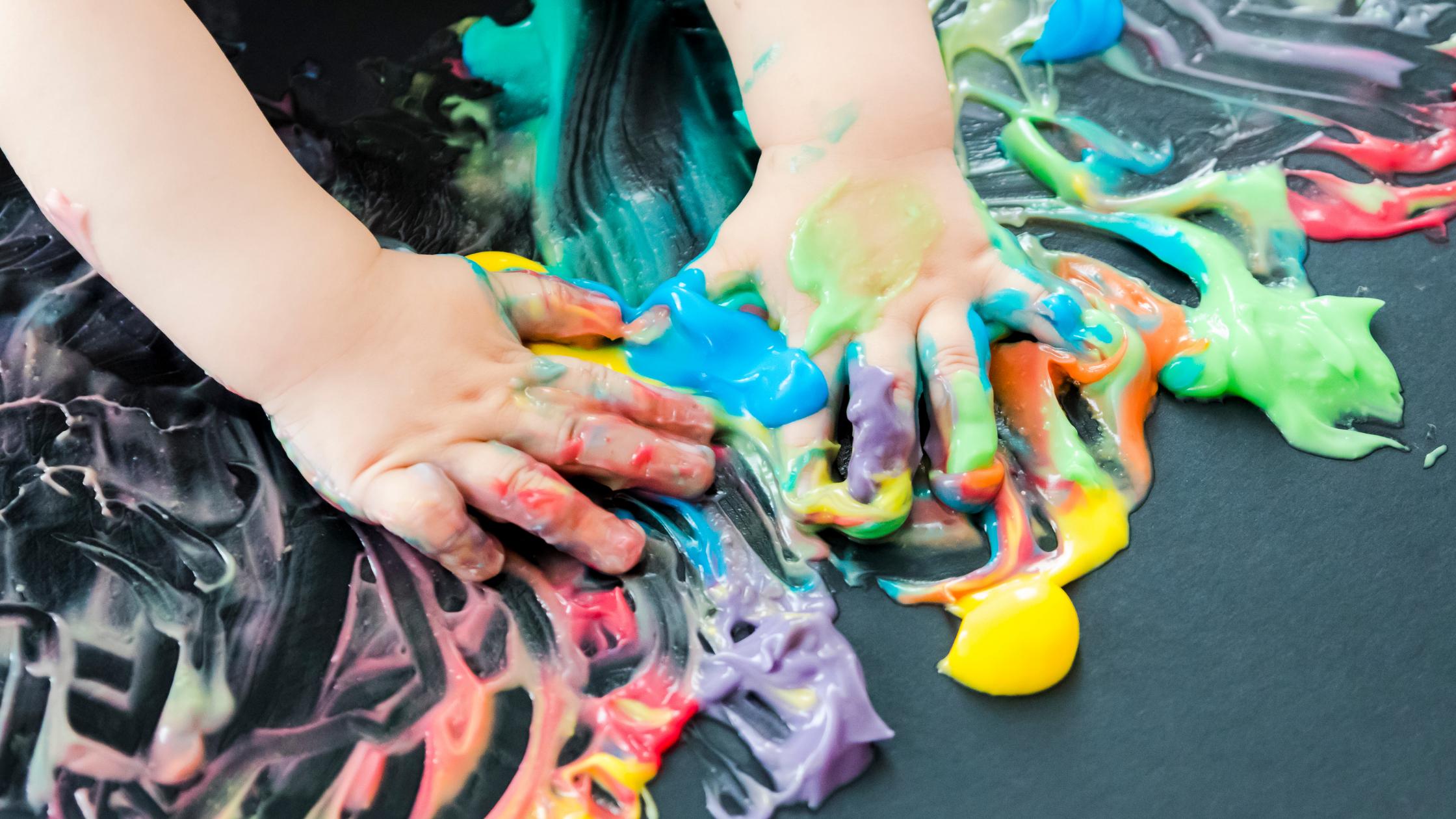 Baby hands in paint